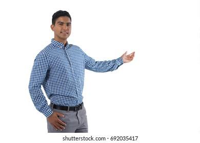 Portrait of man gesturing against white background