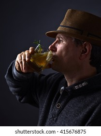Portrait of a man with glass of alcoholic drink