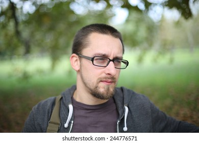 Portrait Of Man With Glasses Autumn Park on a day