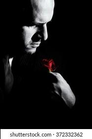 Portrait of man, godfather like character. Black and white studio shot.