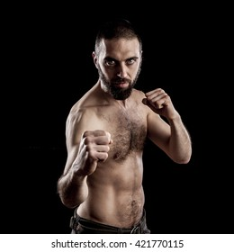 portrait of a man in guard fighting pose on dark background