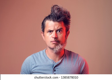 A portrait of man with half beard and hair on brown background