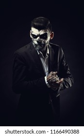 Portrait of man with Halloween skull makeup on the black backgro