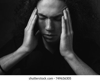 Portrait of a man with a headache. close up. black and white