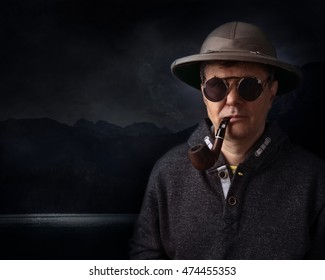 Portrait of a man in helmet with a smoking pipe