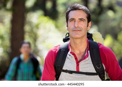 Portrait of man hiking on the wood