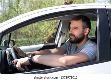 Portrait of man in his car
