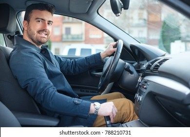 Portrait of man in his car  looking at the  camera