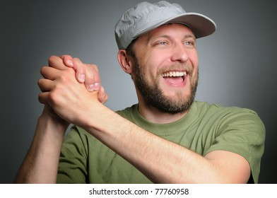 Portrait of a man with his hands in a sign of friendship