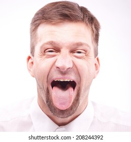Portrait of a man with his tongue out