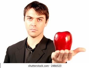 portrait of a man holding an apple
