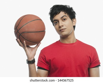 Portrait of a man holding a basket ball