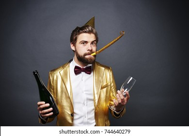 Portrait of man holding bottle of champagne and champagne glass