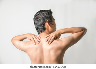 Portrait of a man holding him neck in pain and discomfort standing over whitw background,Concept with Healthcare And Medicine.