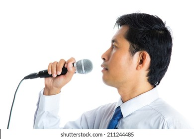 Portrait of a man holding a microphone conducting a business interview or press conference