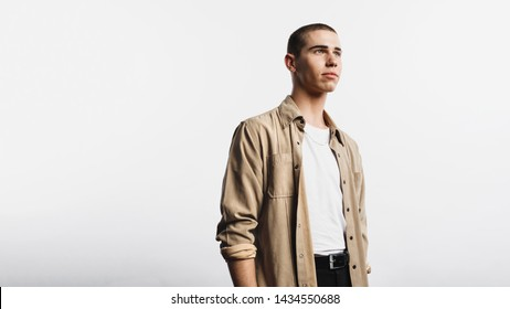 Portrait of man isolated on white background. Young caucasian man looking away.