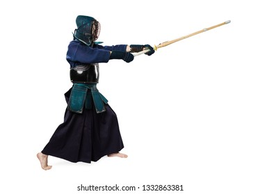 Portrait of man kendo fighter with shinai (bamboo sword). Shot in studio. Isolated with clipping path on white background