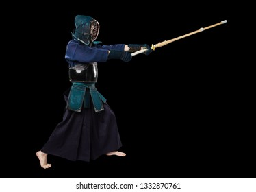 Portrait of man kendo fighter with shinai (bamboo sword). Shot in studio. Isolated with clipping path on black background