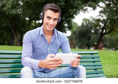 Portrait of a man listening music outdoors