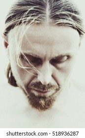 portrait of a man with long blond hair, musician closeup