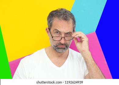 portrait of man looking critical with colorful background