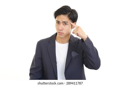 Portrait of man looking uneasy.