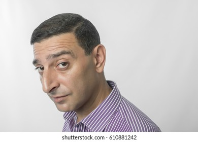 Portrait of a man making funny face against white background