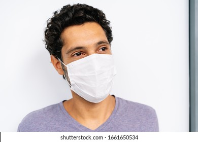 portrait of a man with a medical facemask on white background