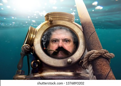 Portrait of man in old diving suit and helmet under water. Funny diver in retro equipment smokes inside helmet.