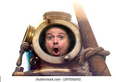 Portrait of man in old diving suit and helmet, isolated on white background. Funny shocked diver in retro equipment look to camera.