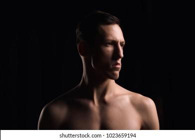 portrait man on black background. Studio light.