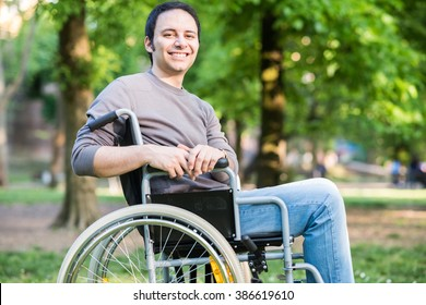 Portrait of a man on a wheelchair in a park