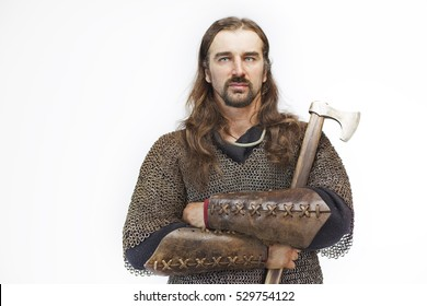portrait of a man on a white background in chain armour, military soldier medieval knight, Viking with an ax in the hands
