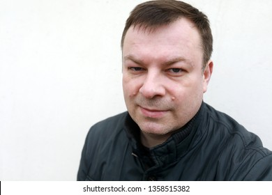 Portrait of man on white wall background