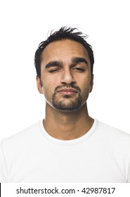 Portrait of a man with one eye closed isolated on a white background