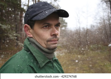 portrait of the man outdoors under the first snow