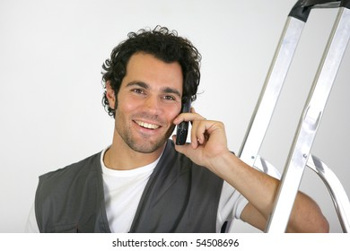 Portrait of a man phoning next to a scale