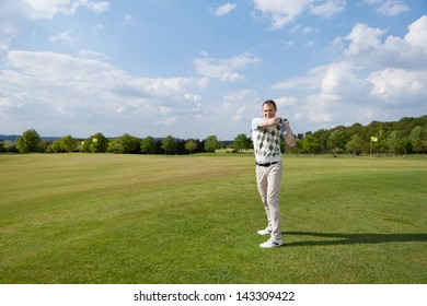 portrait of a man playing golf in summer