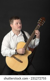 Portrait of a man playing a guitar