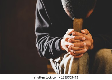 Portrait of a man praying with his eyes closed, spirituality and religion,man praying to god. Christianity concept.