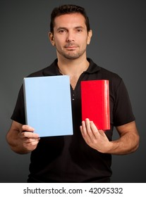 Portrait of a man presenting two objects, a book and a box