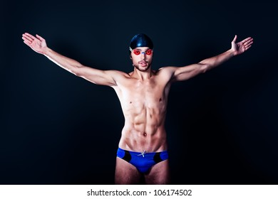 Portrait of a man professional  swimmer, champion enjoying his victory.