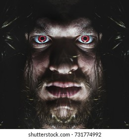 Portrait of a man with a red eye for horror or halloween.