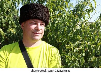 Portrait of man in Russian Karakul Kubanka Cossack Hat