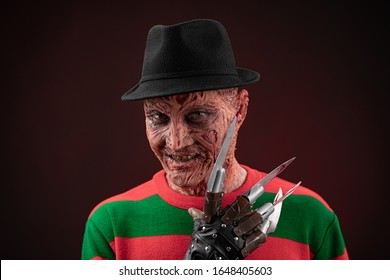 portrait of a man with a scary face and metal claws. Grimm hero for a horror movie. Freddy Krueger. 06 February 2020 Ukraine, Kyiv.