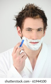 Portrait of a man shaving