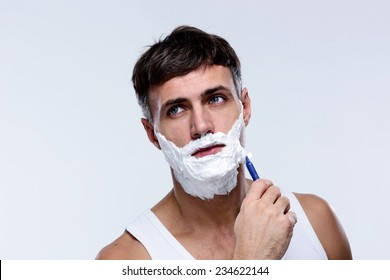 Portrait of a man shaving and looking away
