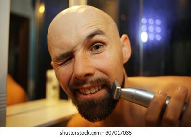 portrait of a man shaving trimer