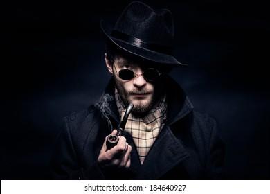Portrait of man, Sherlock Holmes like character, black background