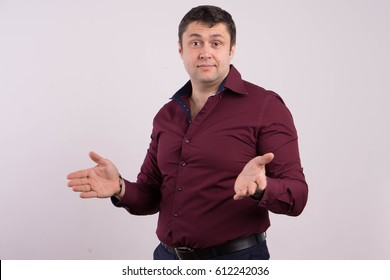 Portrait of a man in a shirt on a white background